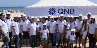 campagne consistant au nettoyage de la plage par la QNB